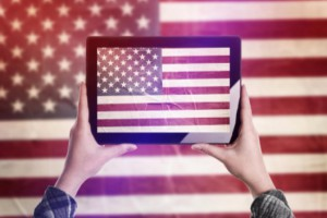 Person holding tablet with American flag: SEO Advantage SEO Technology Blog